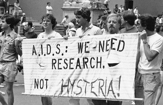 A group advocating AIDS research marches down Fifth Avenue during the 14th annual Lesbian and Gay Pride parade in New York, June 27, 1983.