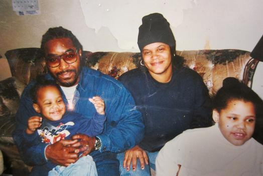 A photo of Alphonza as a toddler being held by his late father Alphonza Bryant, Jr., with his mother, Jenaii van Doten and older sister.