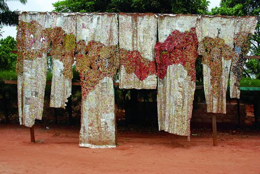 El Anatsui, Drifting Continents, 2009. Photographed by El Anatsui in front of his studio in Nsukka, Nigeria.