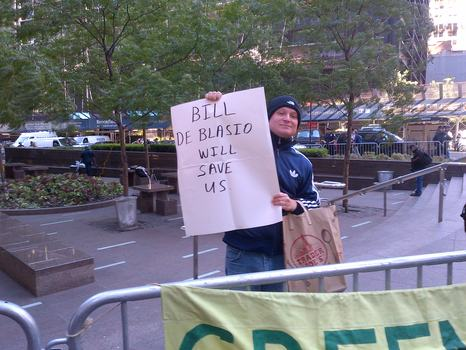 Roman Shusterman, 32, carried the one overt sign supporting Bill de Blasio for mayor at Zuccotti Park on Tuesday.