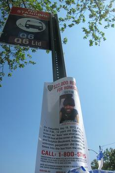A reward poster for the shooter at the bus stop.