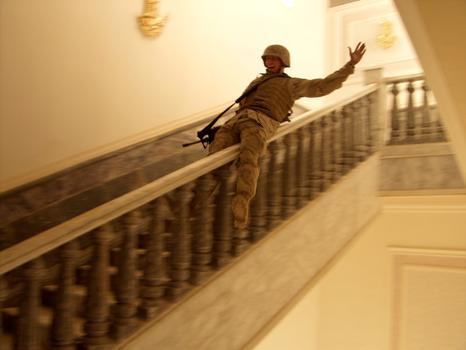 Tikrit April 14, 2003 - In Saddam Hussein's hometown, a US Marine slides down a marble handrail in one of the dictator's extravagant palaces.