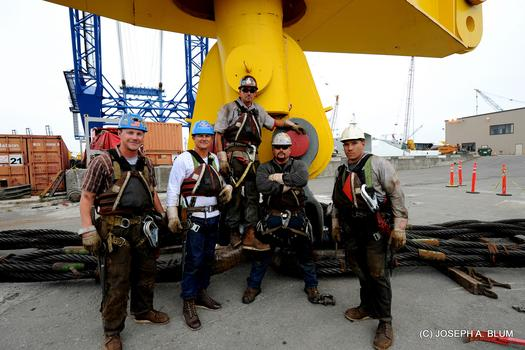Ironworkers on the new eastern span of the Bay Bridge. Matthew Cochran is fourth from left.