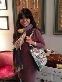 Briones with one of her tote bags.  She got her start selling tote bags at Texas A&M University.