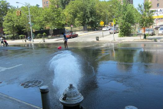 Open hydrant in the South Bronx, E. 149th Street on July 18, 2013