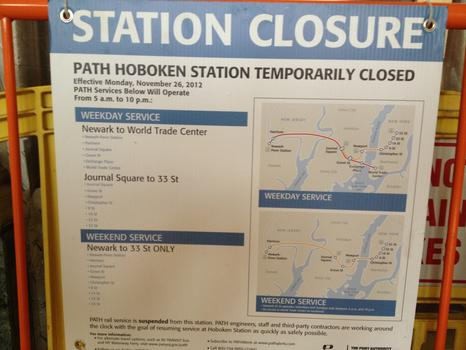 A now-outdated sign warning customers of PATH's Hoboken closure is inside the waiting room
