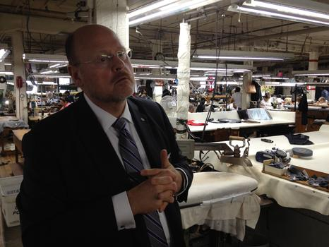 Lhota at Greenfield's suit factory in Bushwick.