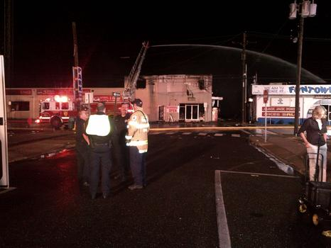 Firefighters survey the scene at the boardwalk fire in Seaside Park, NJ.