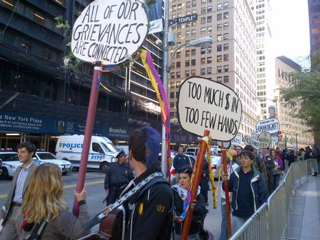Occupy supporters march the perimeter of Zuccotti Park.