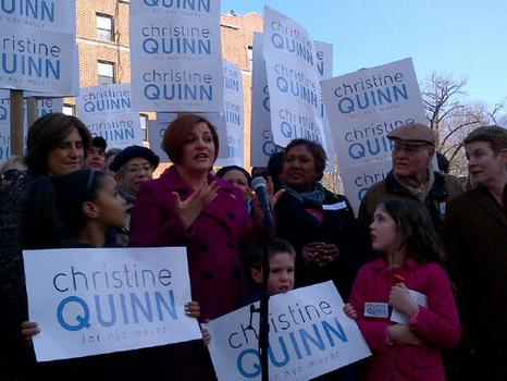 Christine Quinn was joined by her wife Kim Catullo, left, and her father, Lawrence Quinn, right, when she launched her campaign in March.