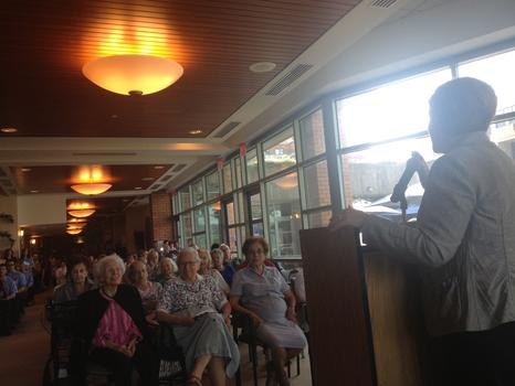 Christine Quinn speaks to a crowd of seniors at the Hebrew Home in the Bronx, where she was asked about policing and hospital closures.