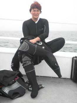 Doreen Doherty suiting up before diving