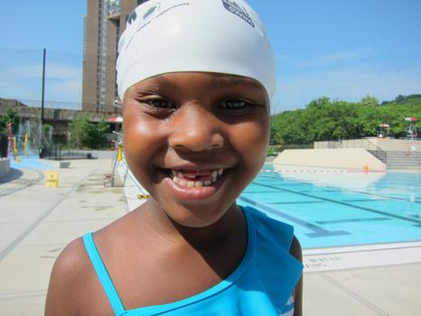 Summer Gaskin, 6, from the Bronx showed off a broad smile as she ended her swimming lesson. More than 500 children are expected to participate in the swimming program.