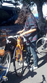 Jun Takeda checking out a bike at the Laney Flea Market in Oakland (Isabel Angell)
