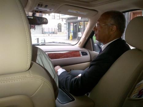 Thompson rides in the front seat as he shuttles between public events.