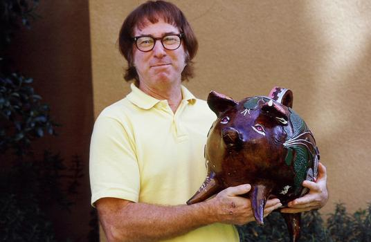 Iconic male chauvinist Bobby Riggs is presented with a pig by Rosie Casals.