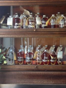 The cocktail cabinet at Saxon + Parole.  For a monthly fee, members get a Cocktail of the Month, mixed and set aside for them in their own bottle.