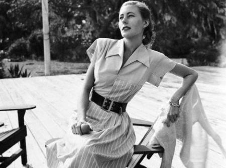 "Claire McCardell with a ""Monastic"" dress, a waistless, dartless shirt dress, 1946"