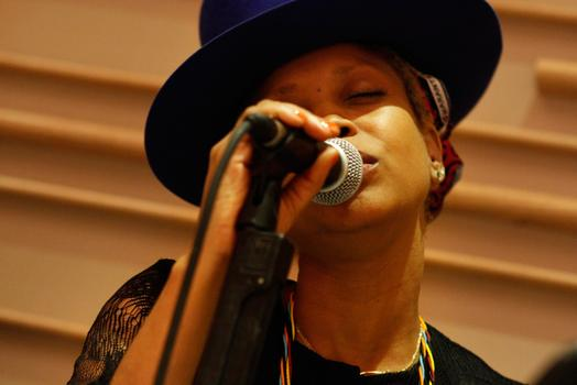 Erykah Badu, singing with the Brooklyn Philharmonic.