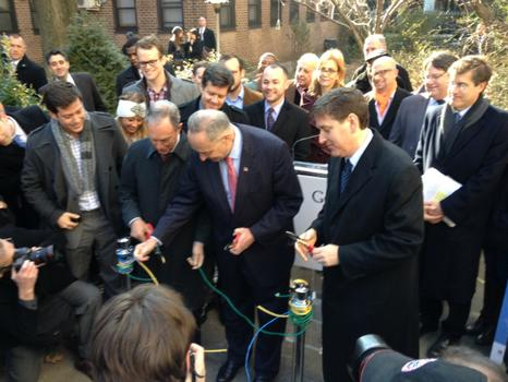 "Senator Charles Schumer, Mayor Michael Bloomberg, and Google's Ben Fried conduct the ""ceremonial cutting of the ethernet cords"" to announce the new free public WiFi network in Chelsea."