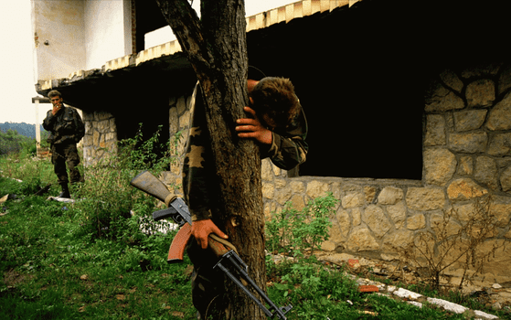 Senad Medanovic, sole survivor of a massacre, finds his home in ruins after the Bosnian army recaptured his village from Serb forces. 1995