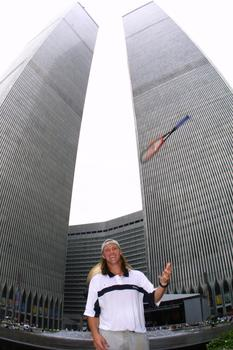 Luke Jensen  tosses a racquet skyward in front of the World Trade Center two weeks before 9/11.