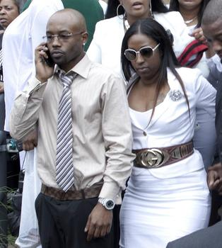D'aja's mother, Shadia Sands (right), leaving her daughter's funeral.