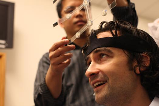 WNYC reporter Ilya Marritz gets his brain scanned. Nine electrodes positioned on the cranium can detect increased brain activity.