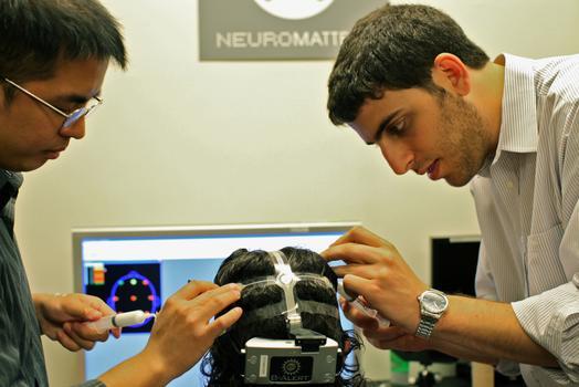 research associate Paul DeGuzman (l.) and research scientist Dan Rosenthal (r.)
