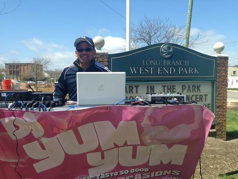 Alonzo Rawls, aka DJ Yum Yum, entertained runners at mile 24. His Long Branch home was flooded from Sandy.