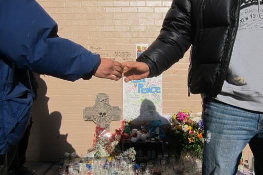 Friends of the Raphael greet each other at his memorial.