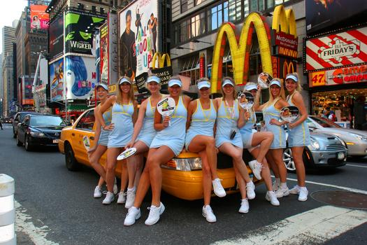 A chorus of Maria Sharapova look-alikes poses in Time Square during the US Open. Art Sietz suggested they sit on the cab.