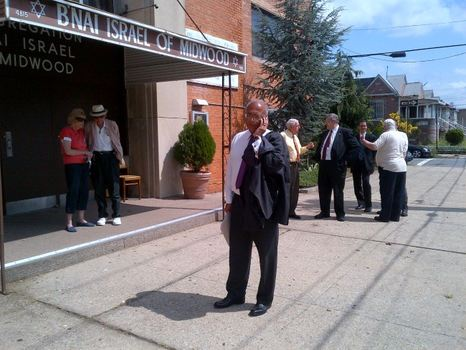 Thompson takes a call before a press conference outside a senior section in Midwood.
