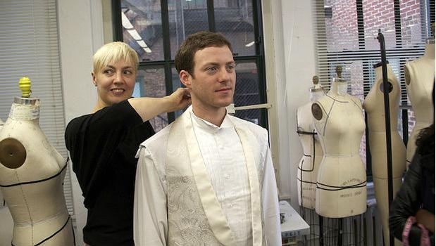 Joseph Gotoff, a Master's student in cello performance at Mannes, is fitted for a jacket prototype at the Parsons School of Design