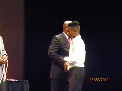 Mike Brown receiving an award