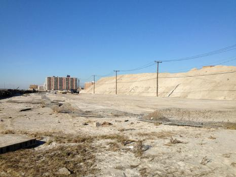 "Residents call this pile of sand, amassed during cleanup after the storm, ""Mount Sandy."""
