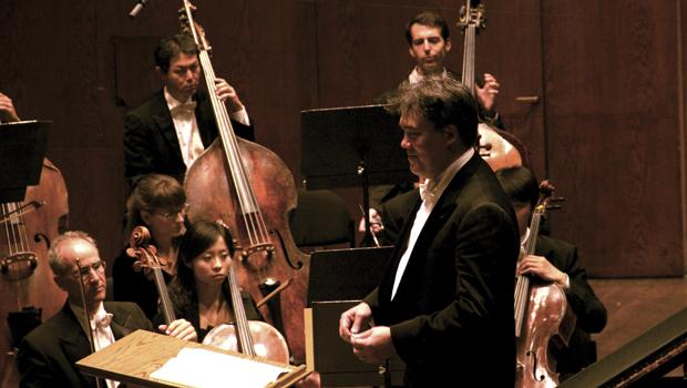 New York Philharmonic conductor Alan Gilbert grins during Wednesday's performance.