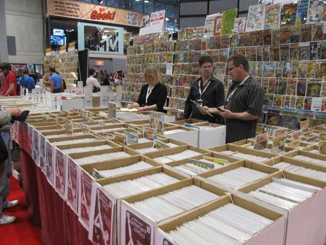 Comic Con attendees pored over hundreds of comics, old and new, boxed for sale.