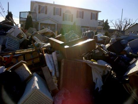The current mission of the DSNY is removing debris piles outside storm affected homes.