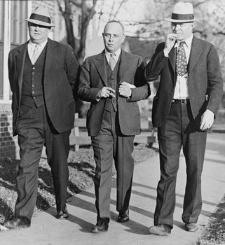Samuel S. Leibowitz (center), attorney for the Scottsboro case defendants, flanked by court appointed bodyguards L.M. Ouzts (left) and W.L. Snow (right), 1933.