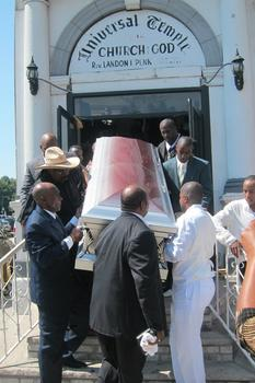 His silver casket being carried out of the church.