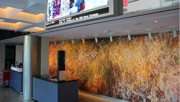 The Sharp lobby at the BAM Richard B. Fisher Building features a mural by Fort Greene artist José Parlá