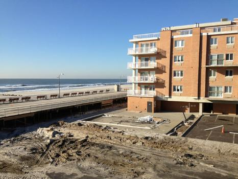 Three weeks later: The same condo building, after extensive cleanup of the parking lot, pool, and surrounding area.