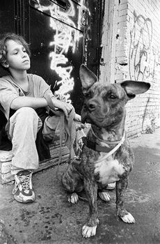 Andy and his dog, sitting in the doorway leading to his Bushwick apartment building, at age eight.