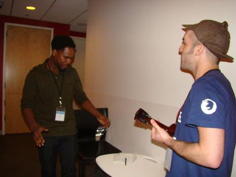 Presenter, John Caggiano (beatboxer & ukulele player) and MC, Bryan Hamilton (rapper & singer), practicing performance
