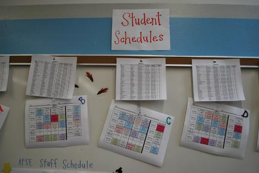 Student schedules hang on a wall in the principal's office at the Academy for Software Engineering