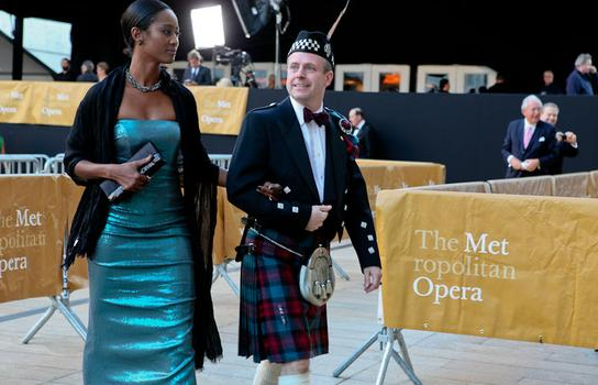 Patrons arrive on the red carpet at the Metropolitan Opera's opening night