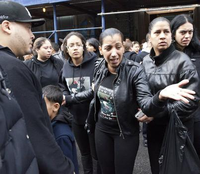 Mother Maria Castro (center) surrounded by other mourners after the funeral.