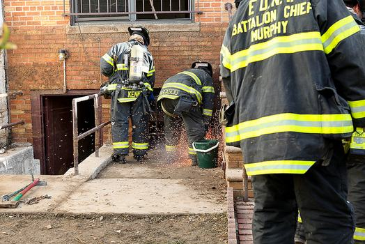 Firefighters putting out a small electrical fire in Coney Island.