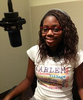 Bree recording narration in the studio